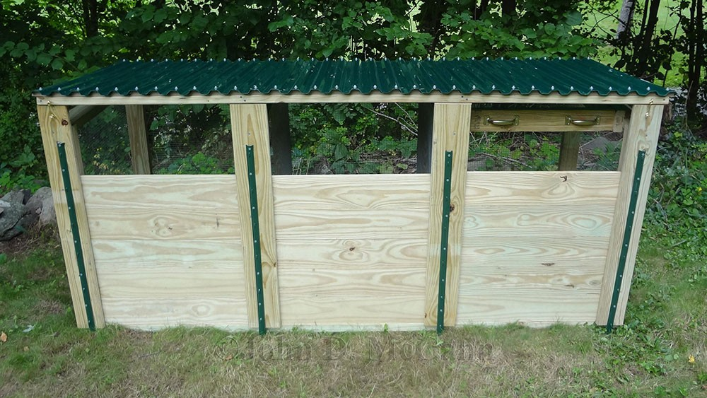 this is a view of the completed three compartment compost bin with the top closed