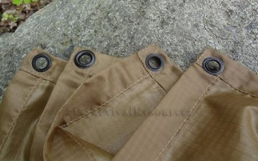 A close-up view of the grommets on the poncho.