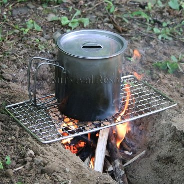 Mini Bushcraft Pack Grill over trench fire